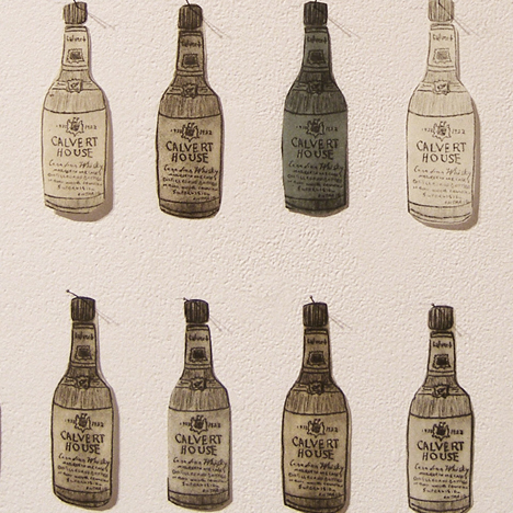 This is a detail of a work of art called 126 Whiskey Bottles by Tara Cooper