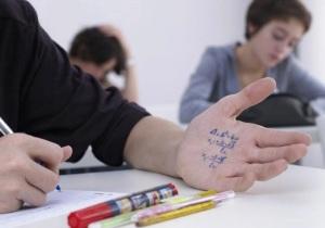 boy_cheating_on_math_test_42-17681679