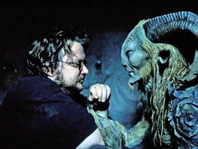 Guillermo del Toro and the faun from Pan's Labyrinth.