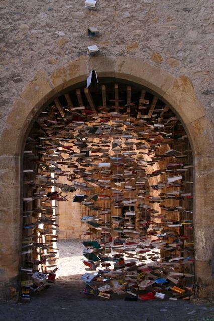 Yes. I also adore books. In 2005, Swiss artist Jan Reymond began constructing elaborate installations each year, made of the old, unsold books as a last hurrah for the soon-to-be discarded objects.